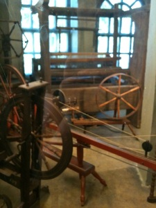 Spinning wheels and a loom