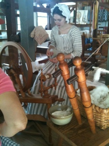 Williamsburg craftswoman, spinning the old fashioned way