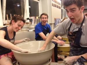 My cousin Christina and some of her students throwing a BIG pot
