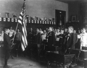 A class saying the pledge of allegiance in 1899.